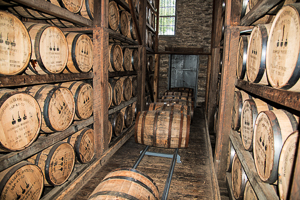 Barrels are moved around in the rick house during aging