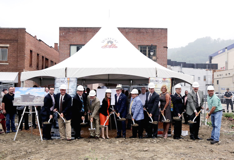Dr. Pearse Lyons, president and founder of Alltech, along with Deirdre Lyons, co-founder of Alltech and Director of Corporate Image and Project Management, break ground with local leaders and contractors on Dueling Barrels Brewing & Distilling Co. in downtown Pikeville, in Eastern Kentucky on July 30, 2015.